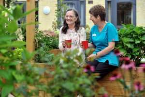 Suzanne enjoying a cuppa with a resident